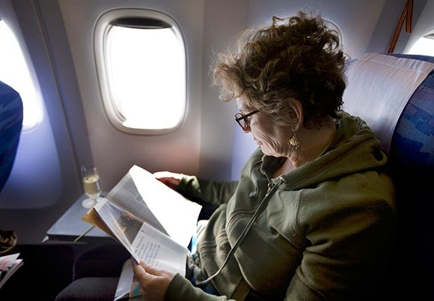 620-reading-magazine-airplane-items-carry-on-esp.imgcache.rev1386245654163.web